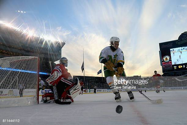 Dennis Maruk of the Minnesota North Stars Alumni skates after the puck in the corner as goaltender Jimmy Waite of the Chicago Blackhawks Alumni looks...