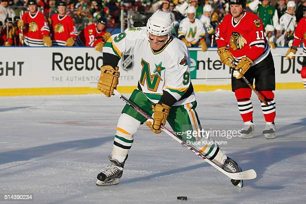 Dennis Maruk of the Minnesota North Stars/Wild scores a goal against the Chicago Blackhawks during the Coors Light NHL Stadium Series Alumni game on...