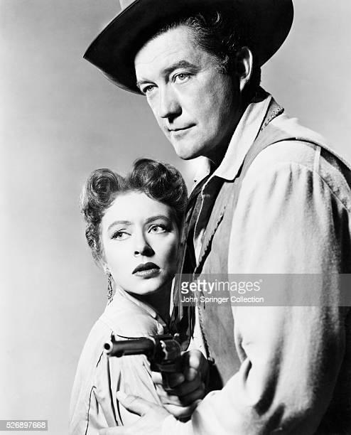 Dennis Morgan as Mike McGann and Amanda Blake as Marian in the 1952 film Cattle Town