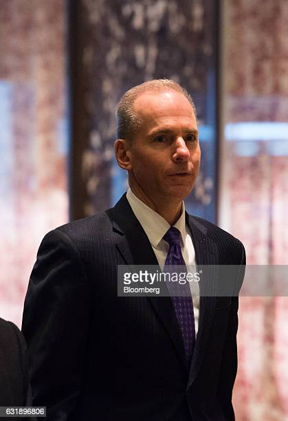 Dennis Muilenburg president and chief executive officer of The Boeing Co arrives in the lobby of Trump Tower in New York US on Tuesday Jan 17 2017...