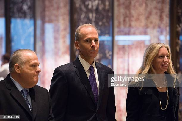 Dennis Muilenburg president and chief executive officer of The Boeing Co center arrives in the lobby of Trump Tower in New York US on Tuesday Jan 17...