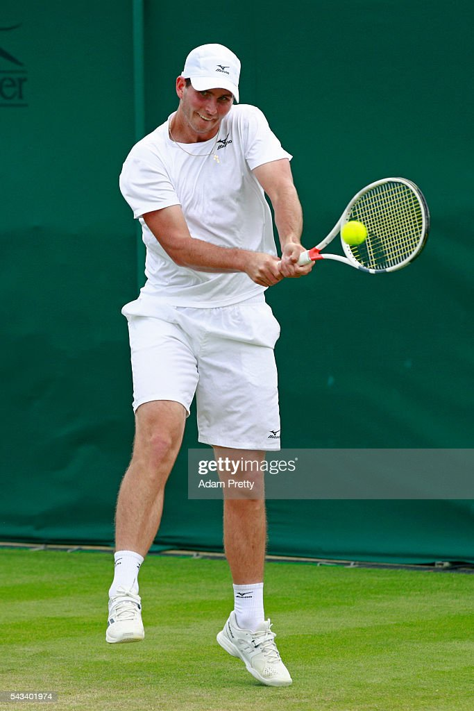 Dennis Novikov of the United States plays a backhand during the Men's Singles first round match against Luke Saville of Australia on day two of the Wimbledon Lawn Tennis Championships at the All England Lawn Tennis and Croquet Club on June 28, 2016 in London, England.