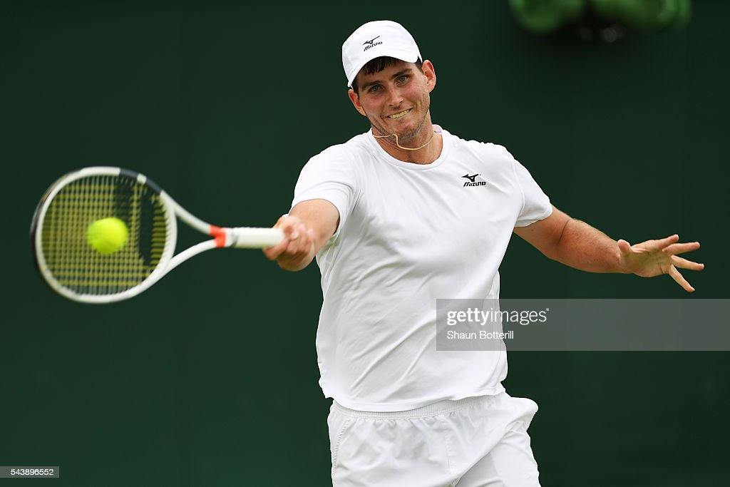 Dennis Novikov of the United States plays a forehand during the Men's Singles second round match against Joao Sousa of Portugal on day four of the Wimbledon Lawn Tennis Championships at the All England Lawn Tennis and Croquet Club on June 30, 2016 in London, England.