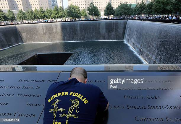 Dennis Palmer of Bayshore NY pays his respects to family and friends at the South Pool of the 9/11 Memorial during ceremonies for the twelfth...