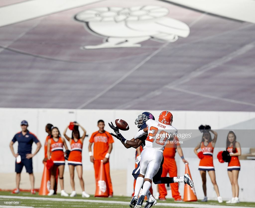 Dennis Parks #4 of the Rice Owls makes a touchdown reception while Ishmael Harrison #2 of the UTEP Miners defends on October 26, 2013 at Rice Stadium in Houston, Texas.