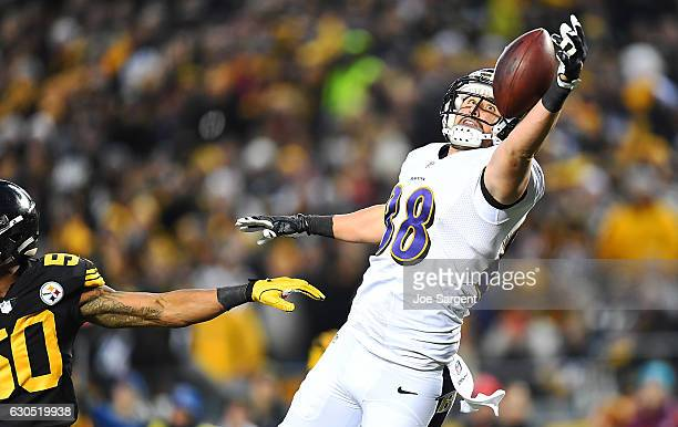 Dennis Pitta of the Baltimore Ravens cannot come up with a pass thrown by Joe Flacco in the first half during the game against the Pittsburgh...