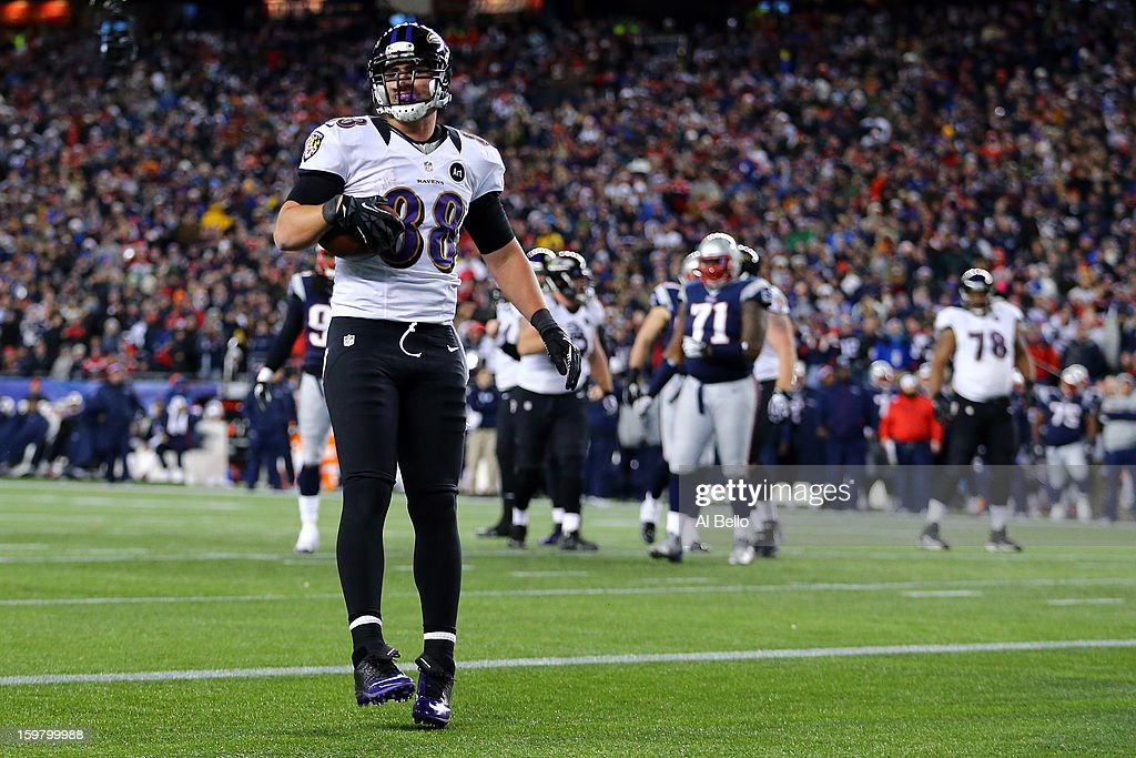 <a gi-track='captionPersonalityLinkClicked' href=/galleries/search?phrase=Dennis+Pitta&family=editorial&specificpeople=5516841 ng-click='$event.stopPropagation()'>Dennis Pitta</a> #88 of the Baltimore Ravens catches a touchdown pass by Joe Flacco #5 in the third quarter against the New England Patriots during the 2013 AFC Championship game at Gillette Stadium on January 20, 2013 in Foxboro, Massachusetts.