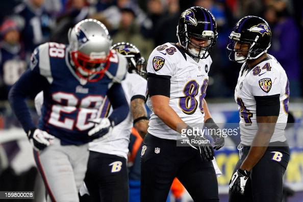 Dennis Pitta of the Baltimore Ravens celebrates with teammate Ed Dickson after catching a touchdown pass by Joe Flacco in the third quarter against...