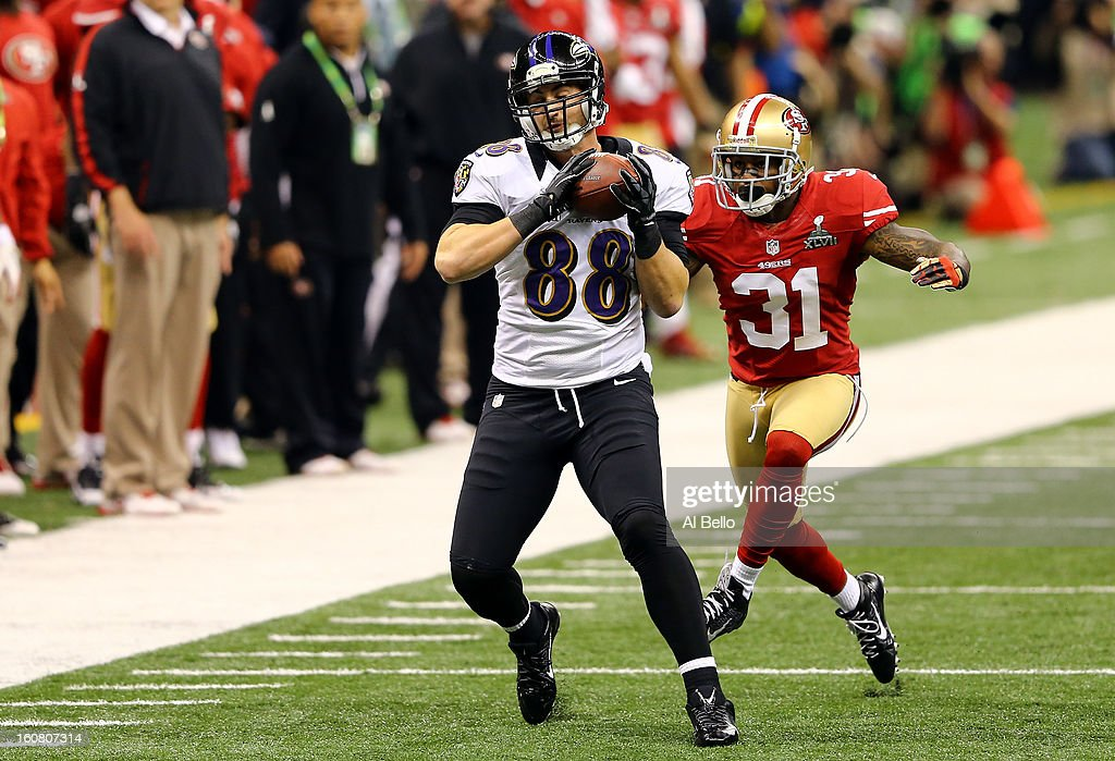 <a gi-track='captionPersonalityLinkClicked' href=/galleries/search?phrase=Dennis+Pitta&family=editorial&specificpeople=5516841 ng-click='$event.stopPropagation()'>Dennis Pitta</a> #88 of the Baltimore Ravens makes a reception against <a gi-track='captionPersonalityLinkClicked' href=/galleries/search?phrase=Donte+Whitner&family=editorial&specificpeople=649027 ng-click='$event.stopPropagation()'>Donte Whitner</a> #31 of the San Francisco 49ers during Super Bowl XLVII at the Mercedes-Benz Superdome on February 3, 2013 in New Orleans, Louisiana. The Ravens won 34-31.