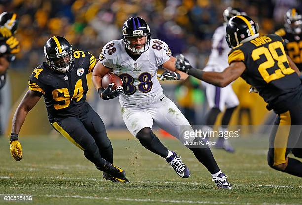 Dennis Pitta of the Baltimore Ravens runs up field after a catch in the fourth quarter during the game against the Pittsburgh Steelers at Heinz Field...