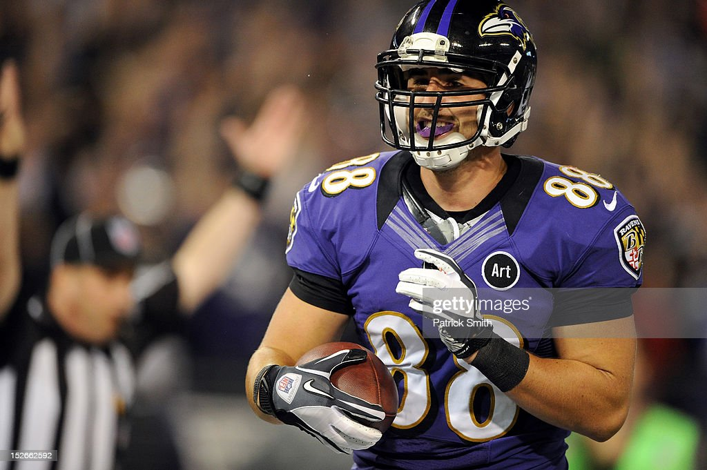 <a gi-track='captionPersonalityLinkClicked' href=/galleries/search?phrase=Dennis+Pitta&family=editorial&specificpeople=5516841 ng-click='$event.stopPropagation()'>Dennis Pitta</a> #88 of the Baltimore Ravens scores a 20-yard touchdown recpetion in the second quarter against the New England Patriots at M&T Bank Stadium on September 23, 2012 in Baltimore, Maryland.