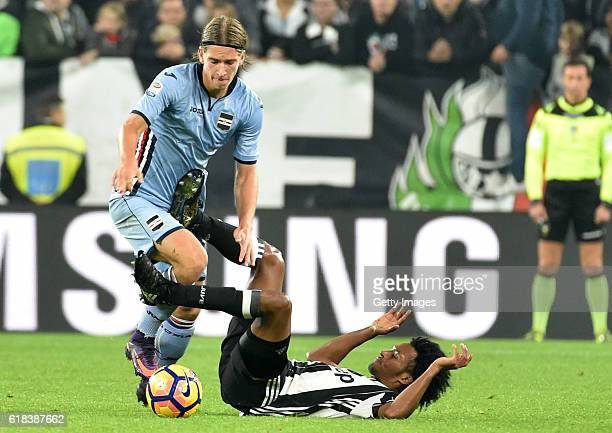 Dennis Praet and Juan Cuadrado during the Serie A match between Juventus FC and UC Sampdoria at Juventus Stadium on October 26 2016 in Turin Italy