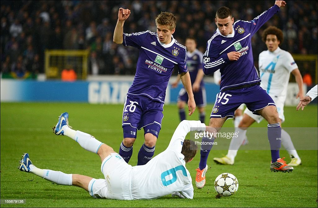 Dennis Praet #26 and Massimo Bruno #45 of RSC Anderlecht in action against Nicolas Lombaerts of FC Zenit St Petersburg during the UEFA Champions League Group C match between RSC Anderlecht and FC Zenit St Petersburg at the Constant Vanden Stock Stadium on November 6, 2012 in Brussels, Belgium.