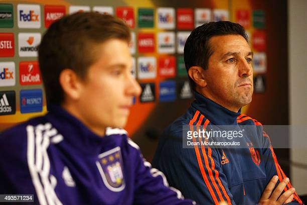 Dennis Praet of Anderlecht and Manager / Head Coach Besnik Hasi speak to the media during a RSC Anderlecht training press conference ahead of the...