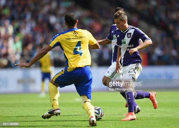 Dennis Praet of Anderlecht and Robson of WaaslandBeveren compete for the ball during the Belgiun Jupilar League match between RSC Anderlecht and...