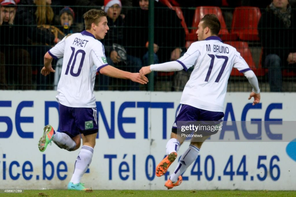 Dennis Praet of RSC Anderlecht celebrates scoring a goal with Massimo Bruno of RSC Anderlecht during the Jupiler League match between Standard Liege and RSC Anderlecht on December 22, 2013 in Liege, Belgium.