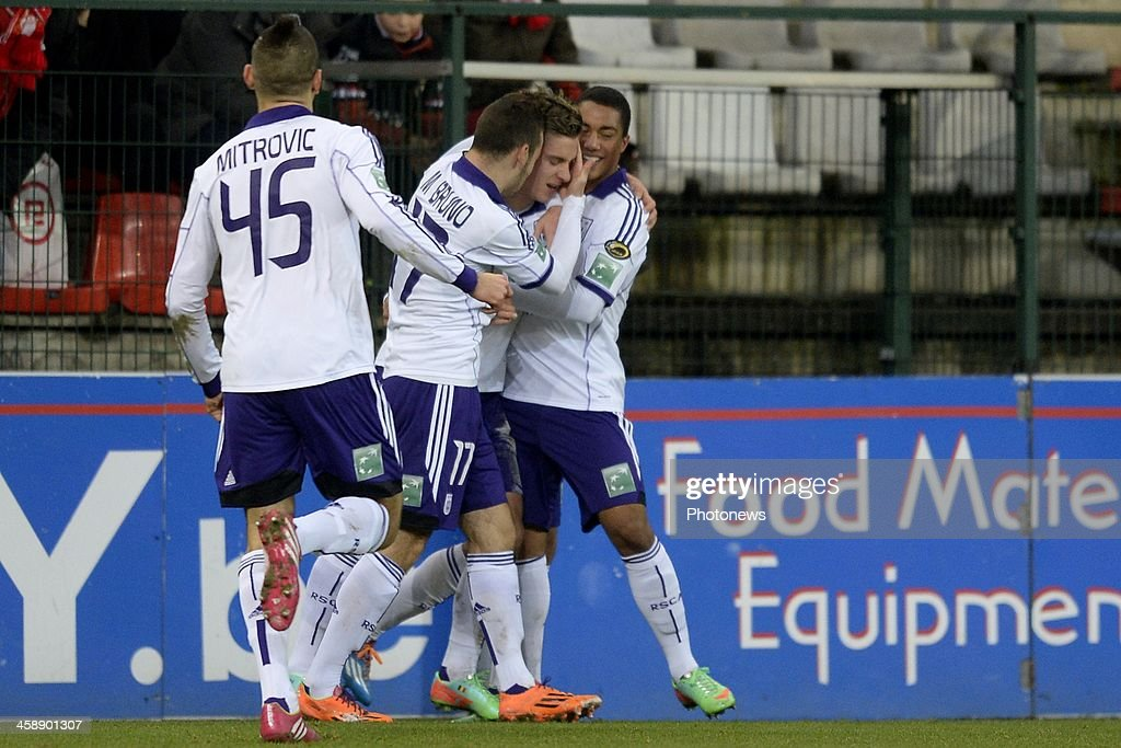 Dennis Praet of RSC Anderlecht celebrates scoring a goal with Aleksandar Mitrovic of RSC Anderlecht, Massimo Bruno of RSC Anderlecht and Youri Tielemans of RSC Anderlecht during the Jupiler League match between Standard Liege and RSC Anderlecht on December 22, 2013 in Liege, Belgium.