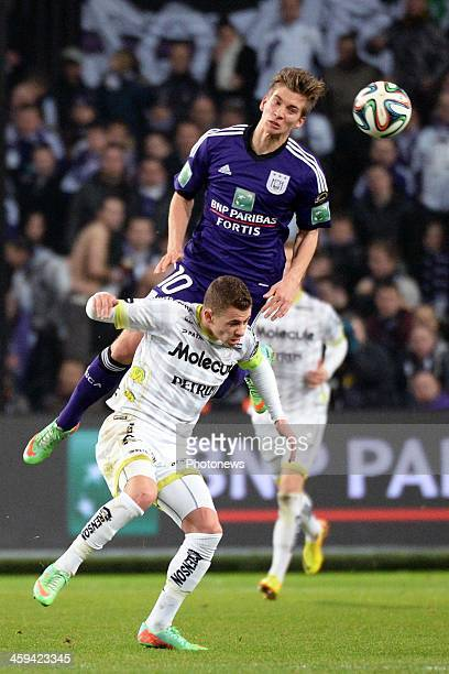 Dennis Praet of RSC Anderlecht challenges Thorgan Hazard of ZulteWaregem during the Jupiler League match between RSC Anderlecht and Zulte Waregem on...