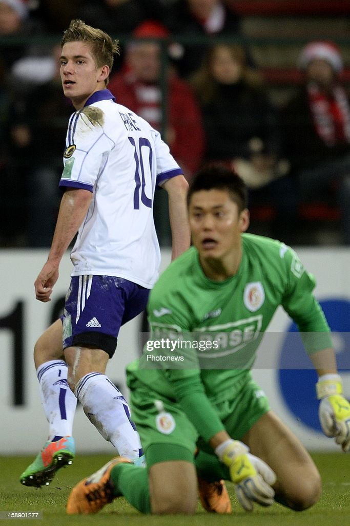 Dennis Praet of RSC Anderlecht scores the opening goal against goalkeeper Eiji Kawashima of Standard during the Jupiler League match between Standard Liege and RSC Anderlecht on December 22, 2013 in Liege, Belgium.