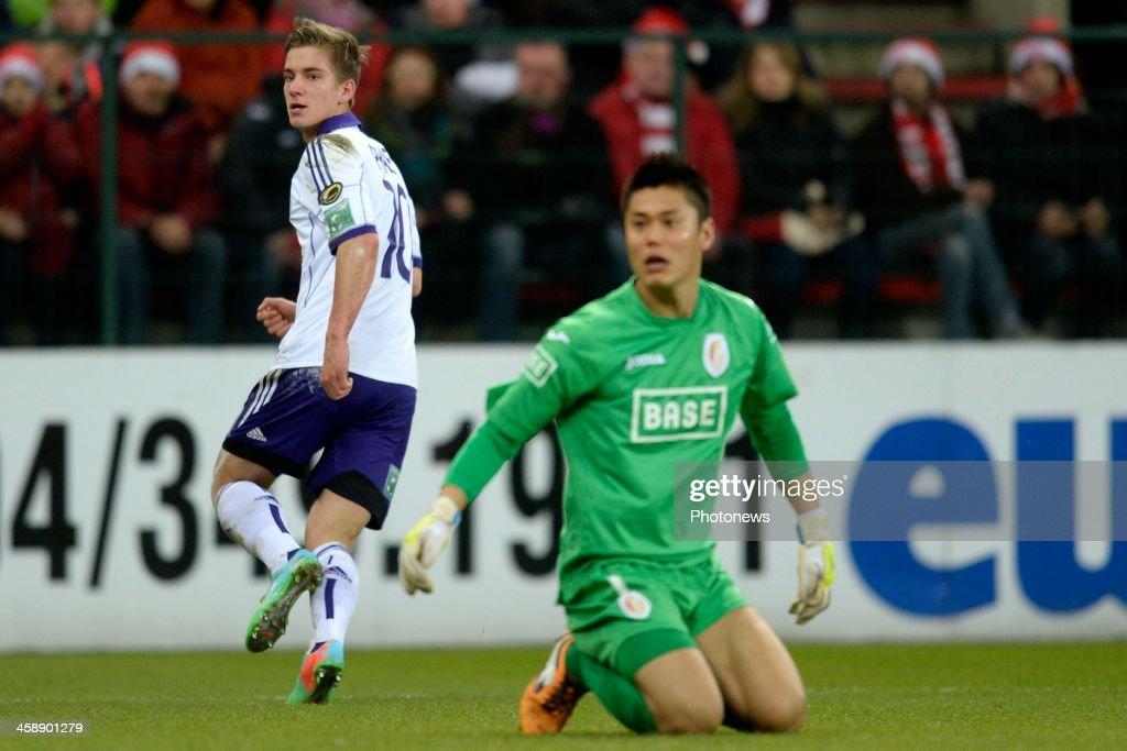 Dennis Praet of RSC Anderlecht scores the opening goal against goalkeeper Eiji Kawashima of Standard during the Jupiler League match between Standard Liege and RSC Anderlecht on December 22, 2013 in Liege, Belgium.