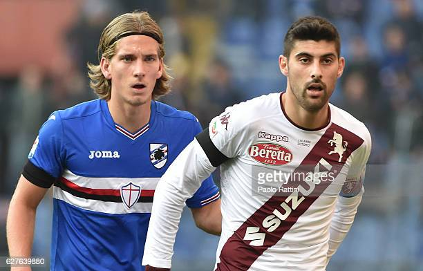 Dennis Praet of Sampdoria and Marco Benassi of Torino during the Serie A match between UC Sampdoria and FC Torino at Stadio Luigi Ferraris on...