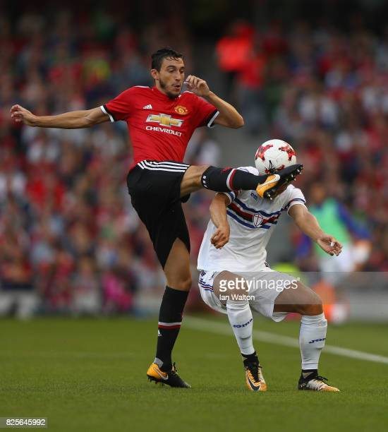 Dennis Praet of Sampdoria is tackled by Matteo Darmian of Manchester United during the International Champions Cup match between Manchester United...