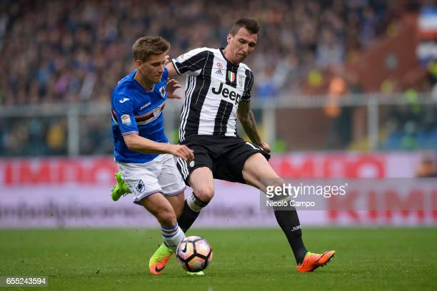 Dennis Praet of UC Sampdoria and Mario Mandzukic of Juventus FC compete for the ball during the Serie A football match between UC Sampdoria and...