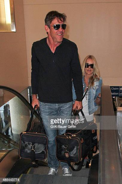 Dennis Quaid and Kimberly Quaid are seen at LAX on August 27 2015 in Los Angeles California