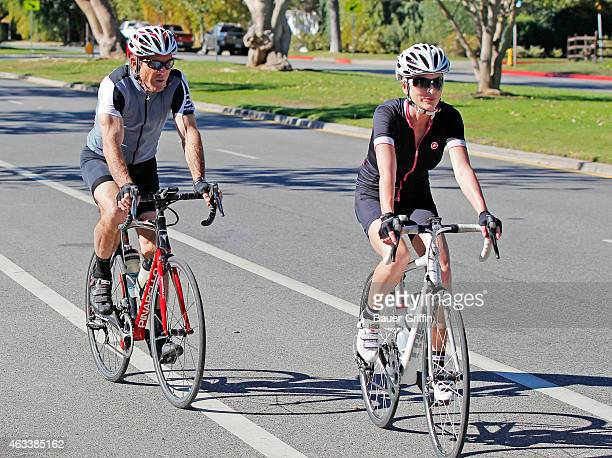Dennis Quaid and wife Kimberly Buffington are seen cycling together on February 13 2015 in Los Angeles California