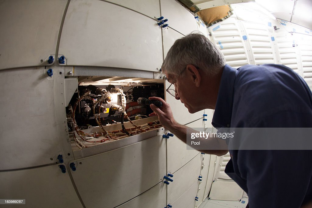 Dennis R. Jenkins of the California Science Center looks into a compartment inside the mid-deck of space Shuttle Endeavour, celebrating the one year anniversary of Endeavour's journey through the street of Los Angeles, on October 10, 2013 in Los Angeles, California. Lynda Oschin, whose foundation helped to bring the shuttle to Los Angeles, formed the Mr. and Mrs. Samuel and Lynda Oschin Foundation, formed in honor of Oschin's late husband, a Los Angeles businessman and philanthropist.