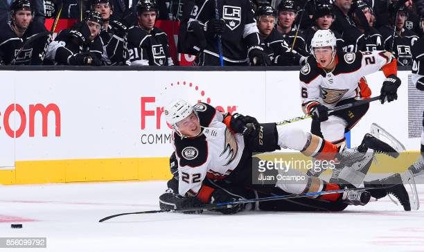 Dennis Rasmussen and Brandon Montour of the Anaheim Ducks battle for the puck during the game against the Los Angeles Kings on September 30 2017 at...