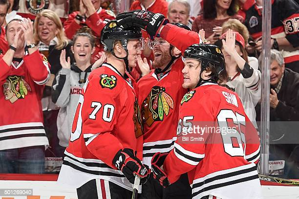 Dennis Rasmussen Bryan Bickell and Andrew Shaw of the Chicago Blackhawks celebrate after Rasmussen scored against the Vancouver Canucks in the third...