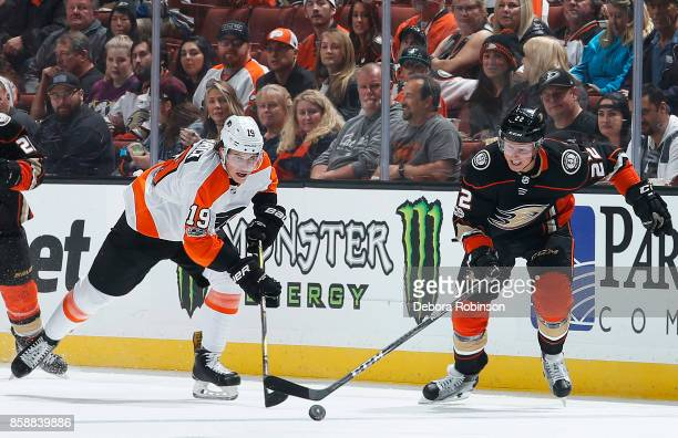 Dennis Rasmussen of the Anaheim Ducks battles for the puck against Nolan Patrick of the Philadelphia Flyers during the game on October 7 2017 at...