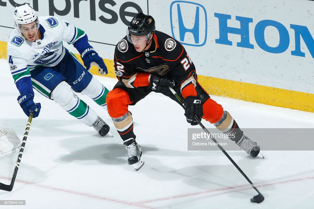 Dennis Rasmussen #22 of the Anaheim Ducks skates with the puck against Michael Del Zotto #4 of the Vancouver Canucks during the game on November 9, 2017 at Honda Center in Anaheim, California.