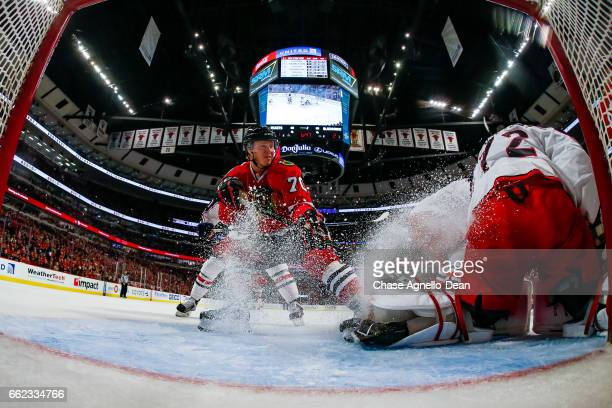 Dennis Rasmussen of the Chicago Blackhawks sprays goalie Sergei Bobrovsky of the Columbus Blue Jackets in the second period at the United Center on...