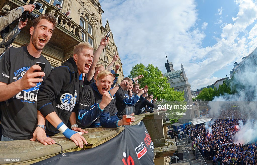 Dennis Riemer, Felix Burmeister and Manuel Hornig of Bielefeld celebrate with the supporters at the town hall after the Third League match between Arminia Bielefeld and VfL Osnabrueck at Schueco Arena on May 11, 2013 in Bielefeld, Germany.
