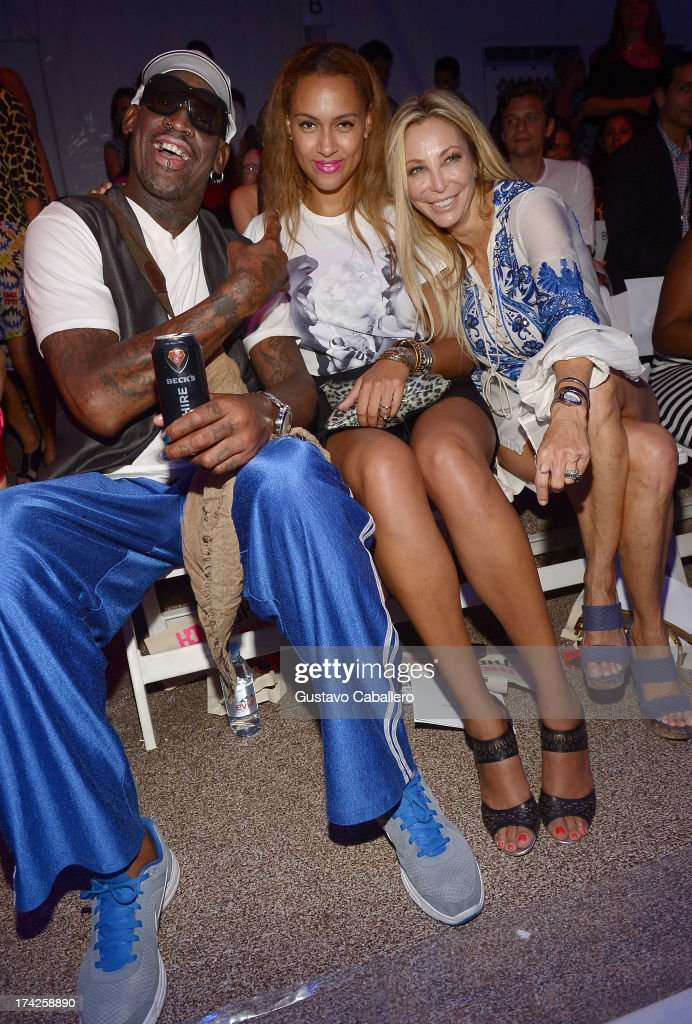 <a gi-track='captionPersonalityLinkClicked' href=/galleries/search?phrase=Dennis+Rodman&family=editorial&specificpeople=202643 ng-click='$event.stopPropagation()'>Dennis Rodman</a>, Alexis Rodman, and Lisa Pliner attend Anna Kosturova/Beach Riot/Lolli Swim/Manglar/Indah show at Mercedes-Benz Fashion Week Swim 2014 at Cabana Grande at the Raleigh on July 22, 2013 in Miami, Florida.