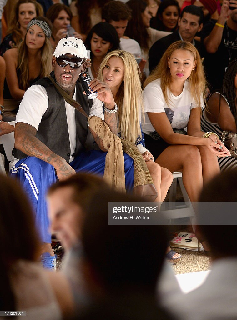 Dennis Rodman, Alexis Rodman, and Lisa Pliner attend the Anna Kosturova/Beach Riot/Lolli Swim/Manglar/Indah show during Mercedes-Benz Fashion Week Swim 2014 at the Raleigh on July 22, 2013 in Miami Beach, Florida.