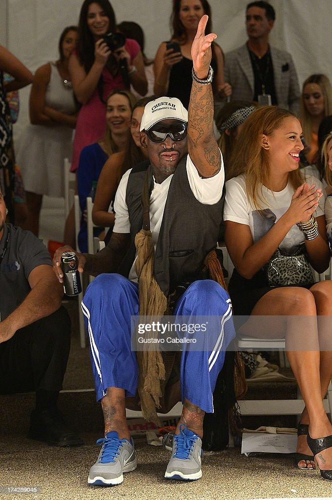 Dennis Rodman (L) and Alexis Rodman attend Anna Kosturova/Beach Riot/Lolli Swim/Manglar/Indah show at Mercedes-Benz Fashion Week Swim 2014 at Cabana Grande at the Raleigh on July 22, 2013 in Miami, Florida.