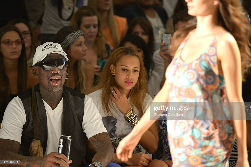<a gi-track='captionPersonalityLinkClicked' href=/galleries/search?phrase=Dennis+Rodman&family=editorial&specificpeople=202643 ng-click='$event.stopPropagation()'>Dennis Rodman</a> and Alexis Rodman attend Anna Kosturova/Beach Riot/Lolli Swim/Manglar/Indah show at Mercedes-Benz Fashion Week Swim 2014 at Cabana Grande at the Raleigh on July 22, 2013 in Miami, Florida.
