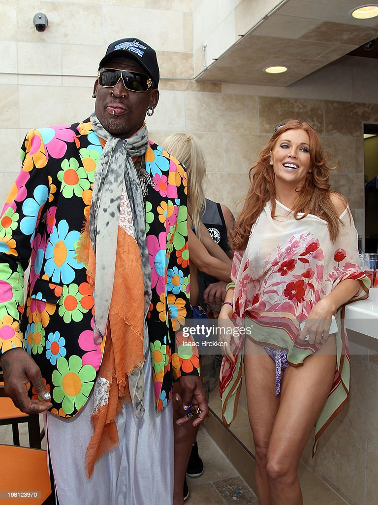 <a gi-track='captionPersonalityLinkClicked' href=/galleries/search?phrase=Dennis+Rodman&family=editorial&specificpeople=202643 ng-click='$event.stopPropagation()'>Dennis Rodman</a> (L) and <a gi-track='captionPersonalityLinkClicked' href=/galleries/search?phrase=Angelica+Bridges&family=editorial&specificpeople=677753 ng-click='$event.stopPropagation()'>Angelica Bridges</a> attend the grand opening of the Sapphire Pool & Day Club on May 5, 2013 in Las Vegas, Nevada.