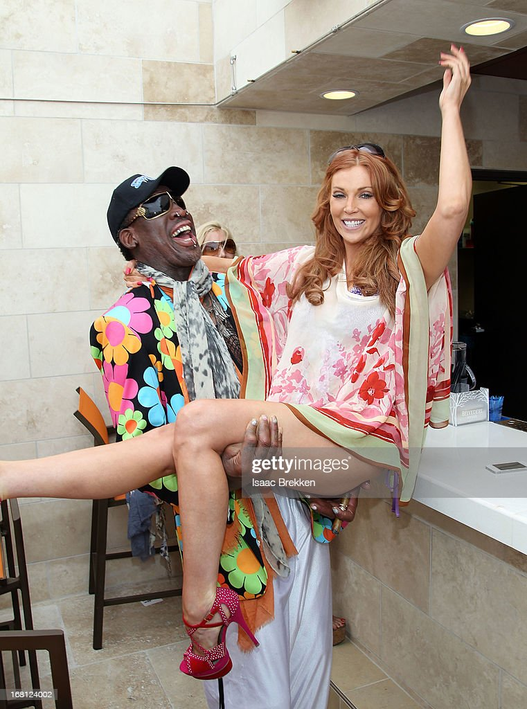 Dennis Rodman (L) and Angelica Bridges attend the grand opening of the Sapphire Pool & Day Club on May 5, 2013 in Las Vegas, Nevada.