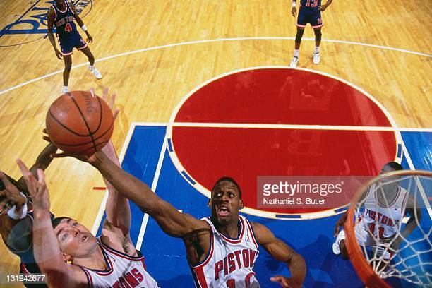 Dennis Rodman and Bill Laimbeer of the Detroit Pistons rebound against the New York Knicks circa 1989 at The Palace of Auburn Hills in Detroit...
