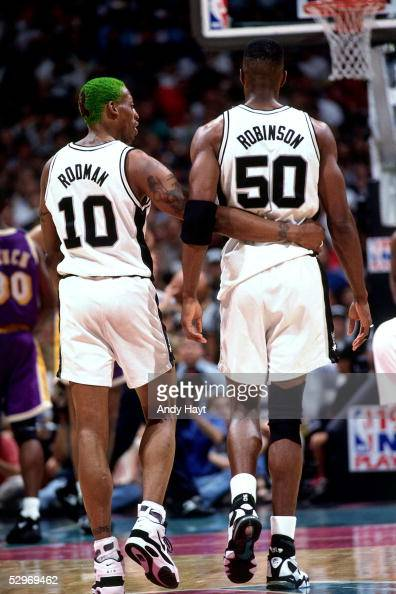 Dennis Rodman and David Robinson of the San Antonio Spurs walk the floor during a break in their NBA game against the Los Angeles Lakers on May 8...