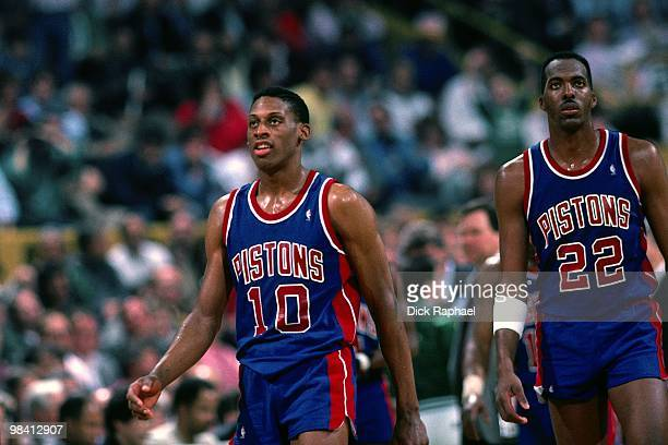 Dennis Rodman and John Salley of the Detroit Pistons stand against the Boston Celtics during a game played in 1989 at the Boston Garden in Boston...