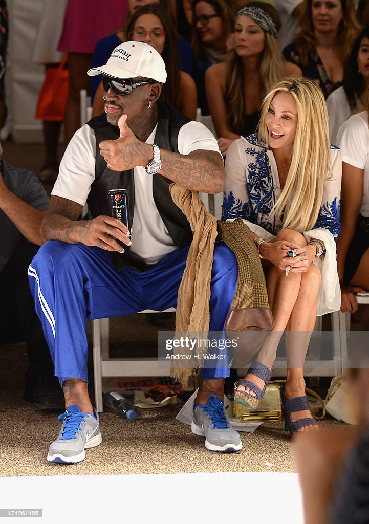<a gi-track='captionPersonalityLinkClicked' href=/galleries/search?phrase=Dennis+Rodman&family=editorial&specificpeople=202643 ng-click='$event.stopPropagation()'>Dennis Rodman</a> and Lisa Pliner attend the Anna Kosturova/Beach Riot/Lolli Swim/Manglar/Indah show during Mercedes-Benz Fashion Week Swim 2014 at the Raleigh on July 22, 2013 in Miami Beach, Florida.