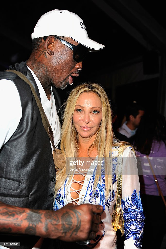 <a gi-track='captionPersonalityLinkClicked' href=/galleries/search?phrase=Dennis+Rodman&family=editorial&specificpeople=202643 ng-click='$event.stopPropagation()'>Dennis Rodman</a> (L) and Lisa Pliner attend the Minimale Animale show during Mercedes-Benz Fashion Week Swim 2014 at Oasis at the Raleigh on July 22, 2013 in Miami, Florida.