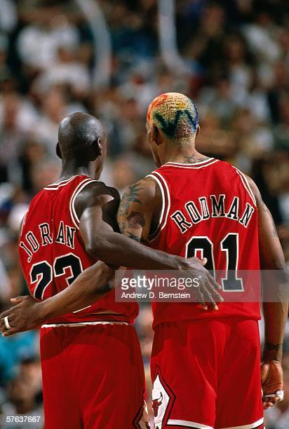 Dennis Rodman and Michael Jordan of the Chicago Bulls hug during Game Three of the NBA Finals against Seattle SuperSonics at Key Arena on June 9 1996...