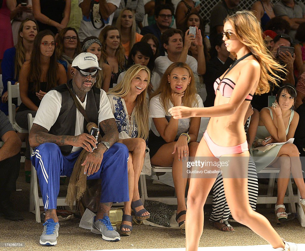 <a gi-track='captionPersonalityLinkClicked' href=/galleries/search?phrase=Dennis+Rodman&family=editorial&specificpeople=202643 ng-click='$event.stopPropagation()'>Dennis Rodman</a>, Lisa Pliner and Alexis Rodman attend Anna Kosturova/Beach Riot/Lolli Swim/Manglar/Indah show at Mercedes-Benz Fashion Week Swim 2014 at Cabana Grande at the Raleigh on July 22, 2013 in Miami, Florida.