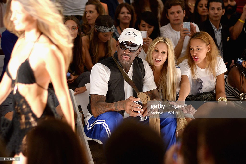 <a gi-track='captionPersonalityLinkClicked' href=/galleries/search?phrase=Dennis+Rodman&family=editorial&specificpeople=202643 ng-click='$event.stopPropagation()'>Dennis Rodman</a>, Lisa Pliner and Alexis Rodman attend the Anna Kosturova/Beach Riot/Lolli Swim/Manglar/Indah show during Mercedes-Benz Fashion Week Swim 2014 at the Raleigh on July 22, 2013 in Miami Beach, Florida.